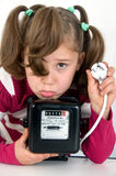 Girl with electricity meter. Sad girl with rotary current meter and plug Stock Photos