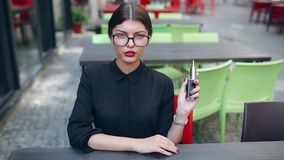 Girl with the electronic cigarette stock video