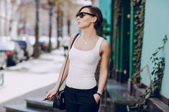 Girl with the electronic cigarette Royalty Free Stock Photo