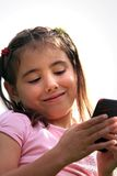 Girl with electronic device Stock Photo