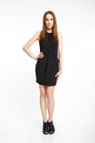 Girl in elegant black dress smiling Stock Photography