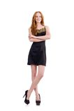 A girl in elegant black mini dress isolated on the Stock Image
