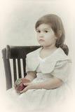 Girl in an elegant dress sits Stock Photo