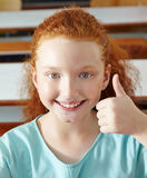 Girl in elementary school holding Stock Photo