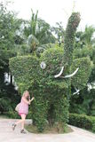 Girl and elephant figure Royalty Free Stock Photography