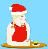 Girl - elf eats cake Royalty Free Stock Photos