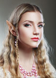 Girl elf princess magical. Stylish portrait of a beautiful young girl elf princess magical Stock Image