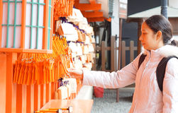 Girl with ema in Japanese shrine Royalty Free Stock Image