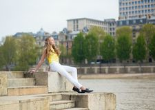 Girl on the embankment in Paris Royalty Free Stock Photos