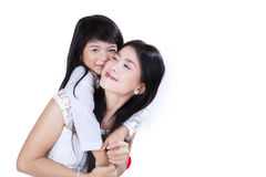 Girl embrace and hug her mother Stock Photos