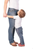 Girl embrace mother legs Royalty Free Stock Photos