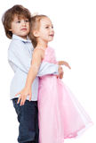 A girl is embraced by little boy Stock Images