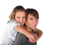 Girl embraces boy from back Stock Photos