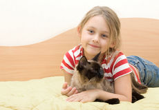 Girl  embraces cat. Little girl tenderly embraces cat Royalty Free Stock Image