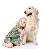 Girl embraces a Golden Retriever. Looking away. isolated on whit Royalty Free Stock Photos