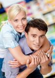 Girl embraces man in the store Royalty Free Stock Images