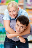 Girl embraces man in the supermarket Royalty Free Stock Photos
