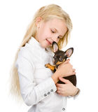 The girl embraces a puppy. Stock Photos