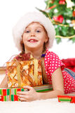 Girl embracing Christmas presents Stock Image
