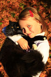 Girl embracing with her cat in Autumn Stock Photography