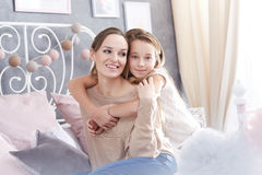 Girl embracing her happy mother Stock Photo