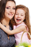 Girl embracing mother Stock Images