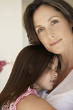 Girl Embracing Mother At Home Royalty Free Stock Photos