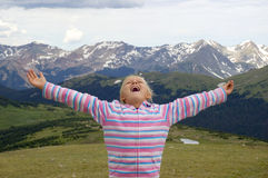 Girl Embracing the Mountains. Young Girl Embracing the Mountain Landscape at Rocky Mountain National Park, Colorado Stock Images