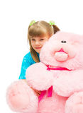 Girl embracing a pink bear. The image of the girl embracing a pink bear Stock Photos