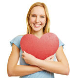 Girl embracing red heart as love symbol Stock Images