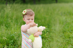 Girl Embracing Toy Royalty Free Stock Image