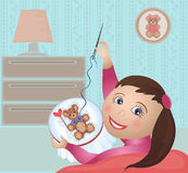 Girl embroiders cross-stitch Stock Photos