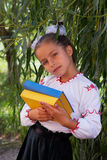 Girl in embroidery books with color Ukrainian flag Royalty Free Stock Images