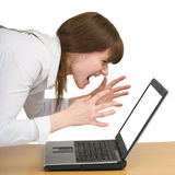 Girl emotionally shouts at the laptop Royalty Free Stock Photos