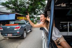 The girl in the taxi Royalty Free Stock Image