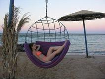 Girl on empty beach. Girl on empty evening beach Royalty Free Stock Image