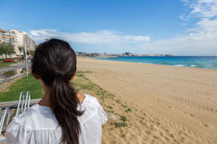 Girl on the empty beach in Spain at autumntime Royalty Free Stock Photos