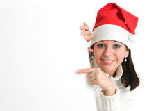 Girl with empty board. Young attractive brunette pointing to empty board. Isolated over white Stock Image