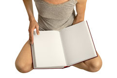 Girl with empty book. Young woman with open, empty book on knees Stock Photo