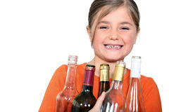 Girl with empty bottles Royalty Free Stock Images