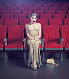 Girl in an empty cinema Stock Image