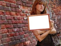 Girl with empty frame Royalty Free Stock Photo