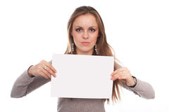 Girl with the empty list. The image of girl with the empty list of paper in her hands. This list must be used as the place of your text Royalty Free Stock Photo