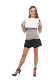 Girl with the empty list. The image of girl with the empty list of paper in her hands. This list must be used as the place of your text Royalty Free Stock Image