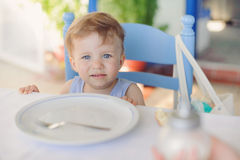 Girl and Empty Plate Royalty Free Stock Images