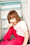 Girl in Empty Refrigerator Royalty Free Stock Images