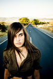 Girl in empty road. Young girl who seems confused in an empty road Royalty Free Stock Photos