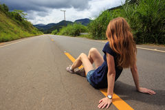 Girl at the empty road at Brazil Royalty Free Stock Images
