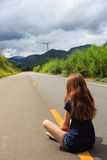 Girl at the empty road at Brazil Stock Photo