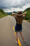 Girl at the empty road at Brazil Stock Images